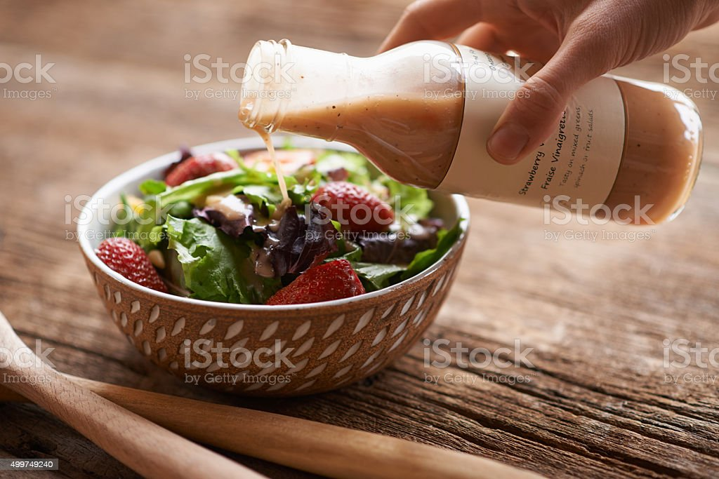 Complement your salad with a delicious salad dressing stock photo