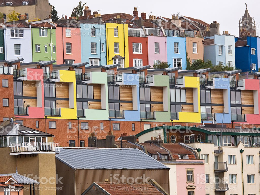 Complementary colors of modern and traditional housing overlooking Bristol harbour stock photo
