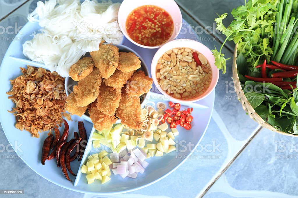 Complementing deep fried fish served with spices and herbs. stock photo