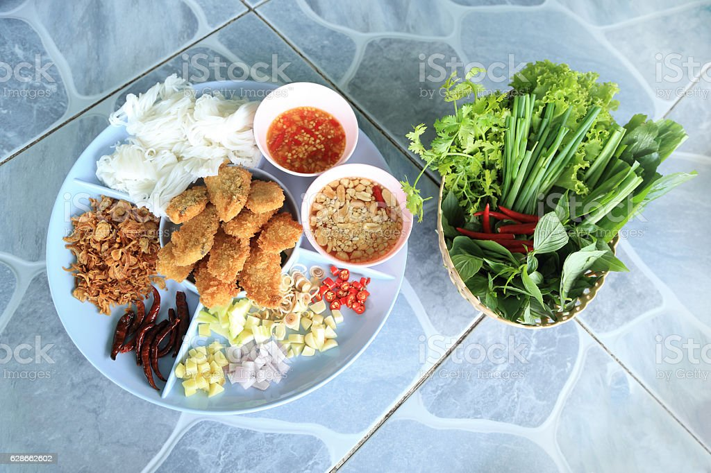 Complementing recipe - fried fish served with spices and herbs. stock photo
