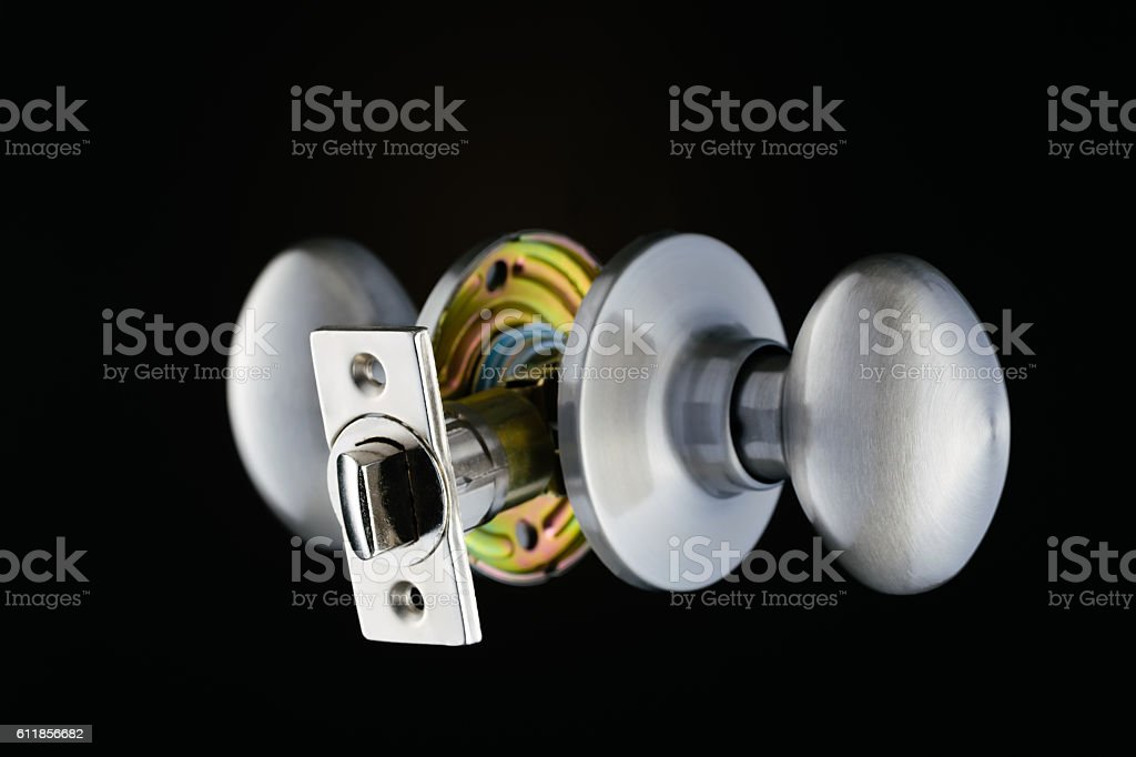 Complete door knob mechanism isolated on black background stock photo