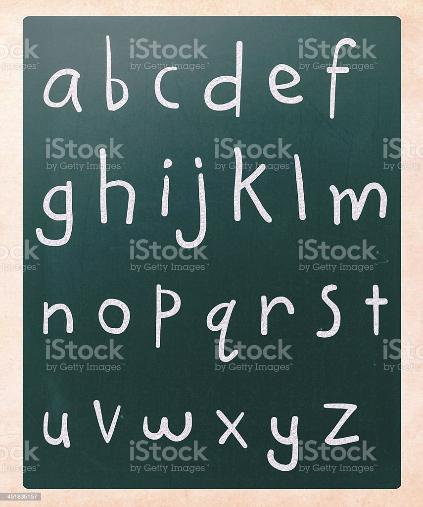 Complete english alphabet handwritten with white chalk on a blac stock photo