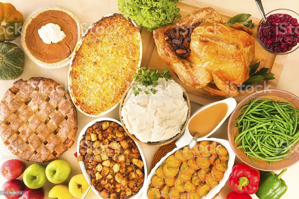 Complete Thanksgiving Dinner with Roast Turkey and Trimmings Horizontal stock photo