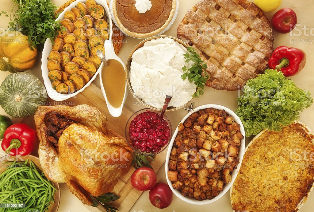 Complete Thanksgiving Dinner with Turkey, Stuffing, and Trimmings, Overhead View stock photo