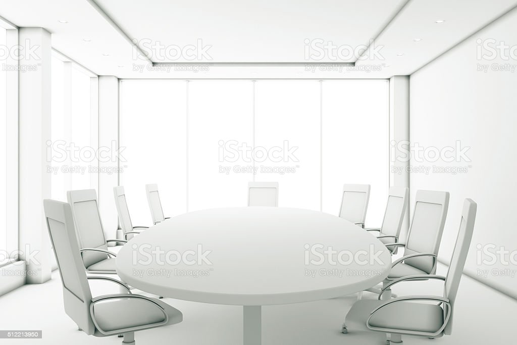 Completely white meeting room with a round table stock photo