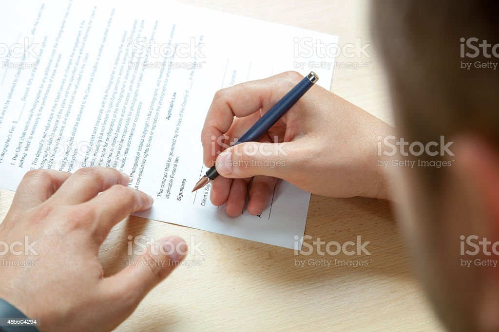 Completing forms stock photo