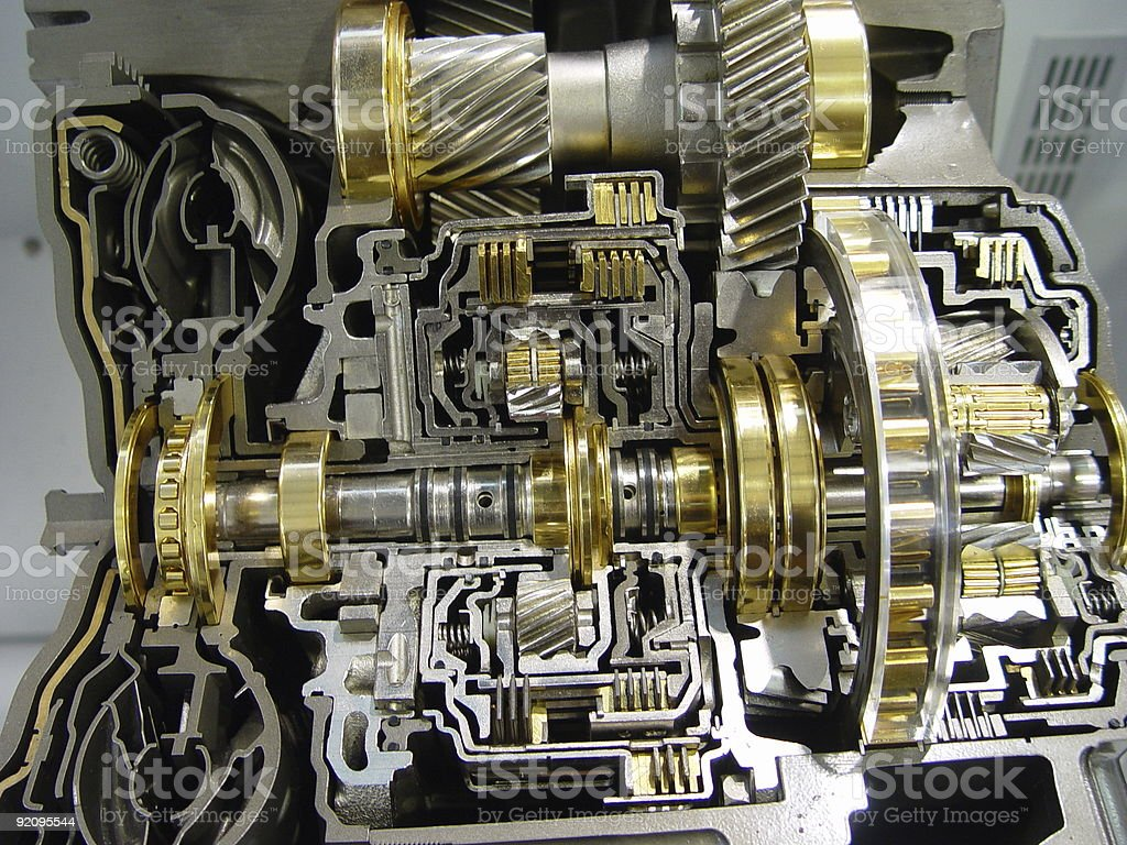 Complex inside of a gear-box with assorted gears together stock photo