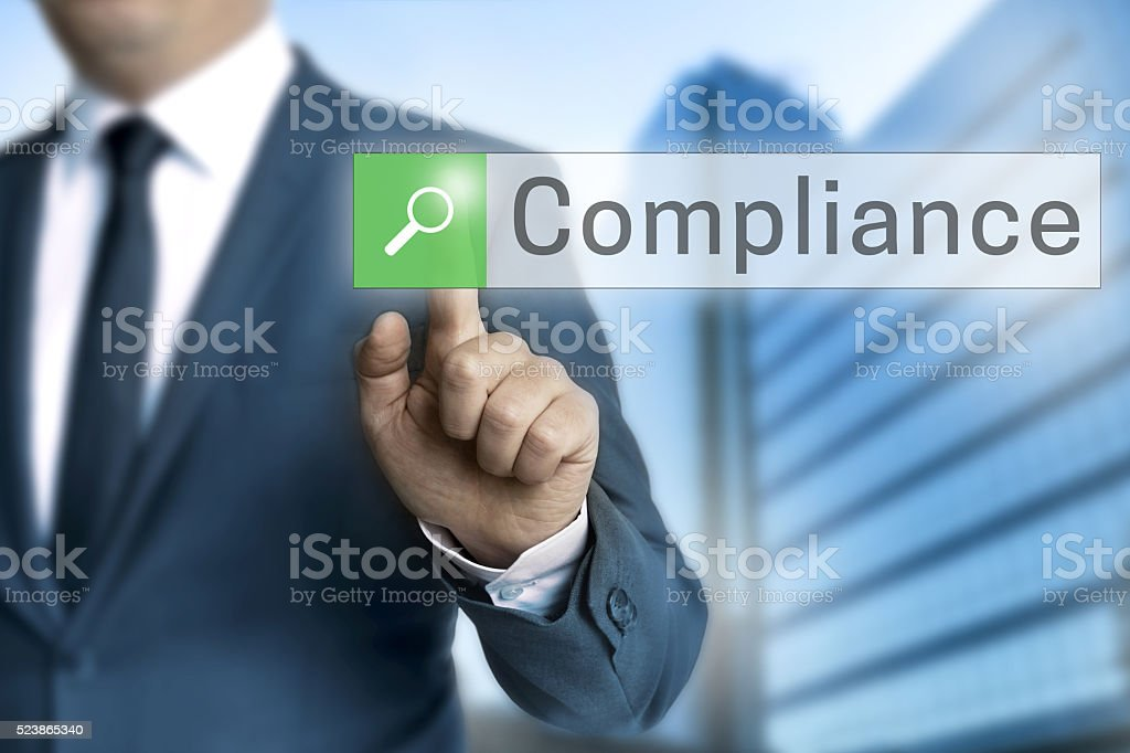 compliance browser operated by businessman stock photo