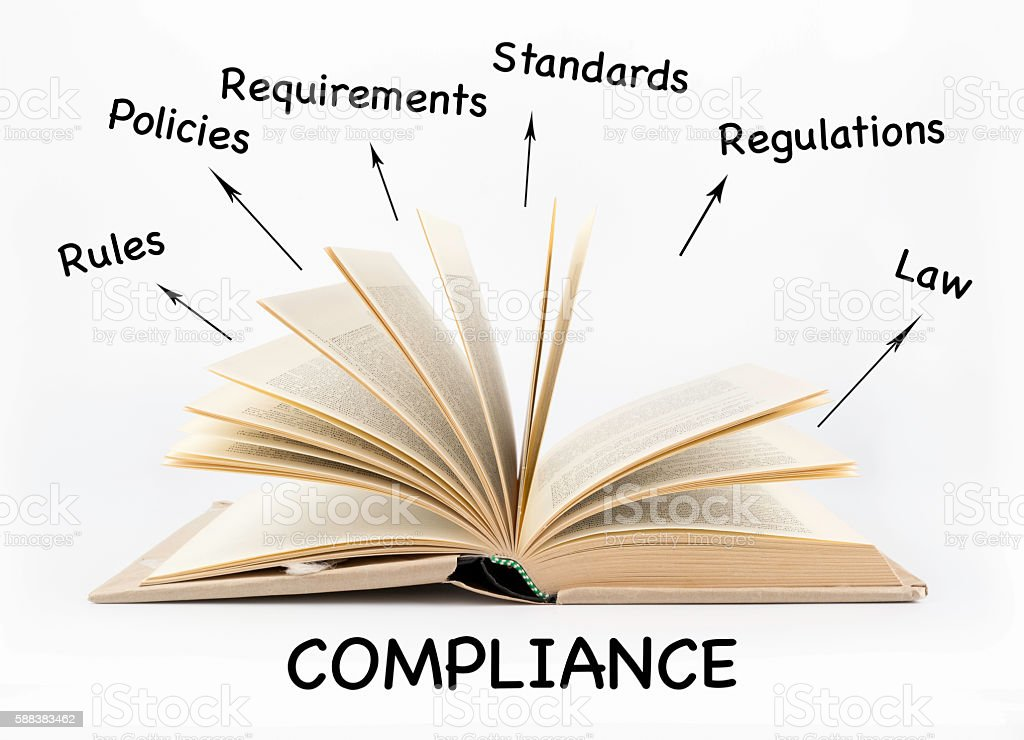 Compliance concept. Open book on a white background stock photo