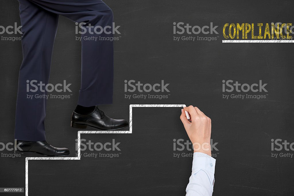 Compliance Stairs on Blackboard Teamwork Concept stock photo