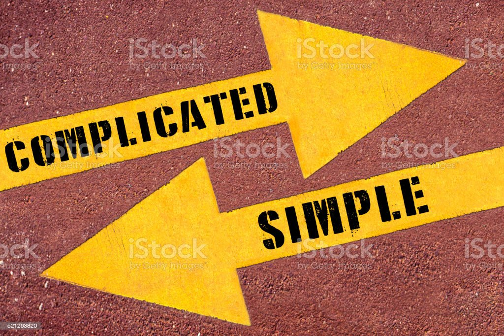 Complicated and Simple  painted on asphalt road stock photo
