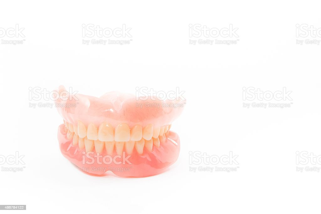 complte denture on white background stock photo