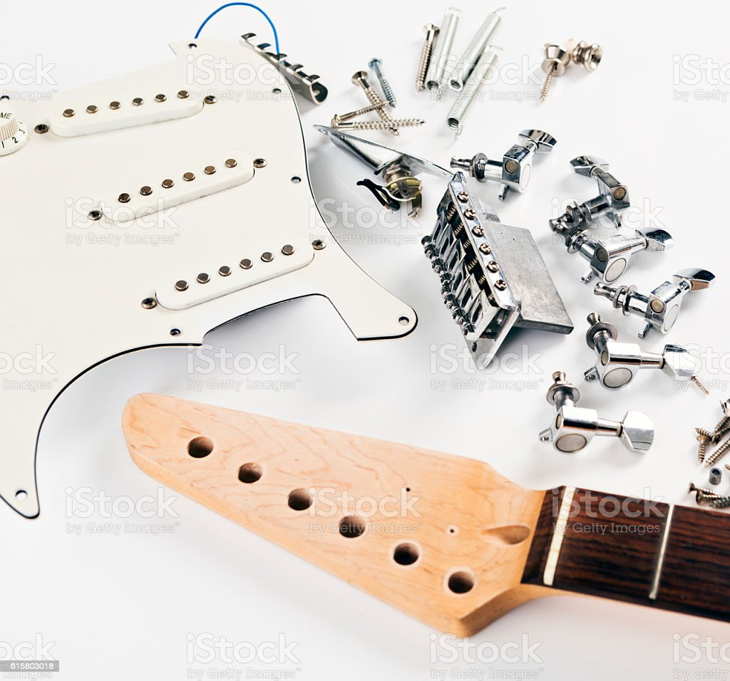 Components of an electric guitar awaiting assembly stock photo