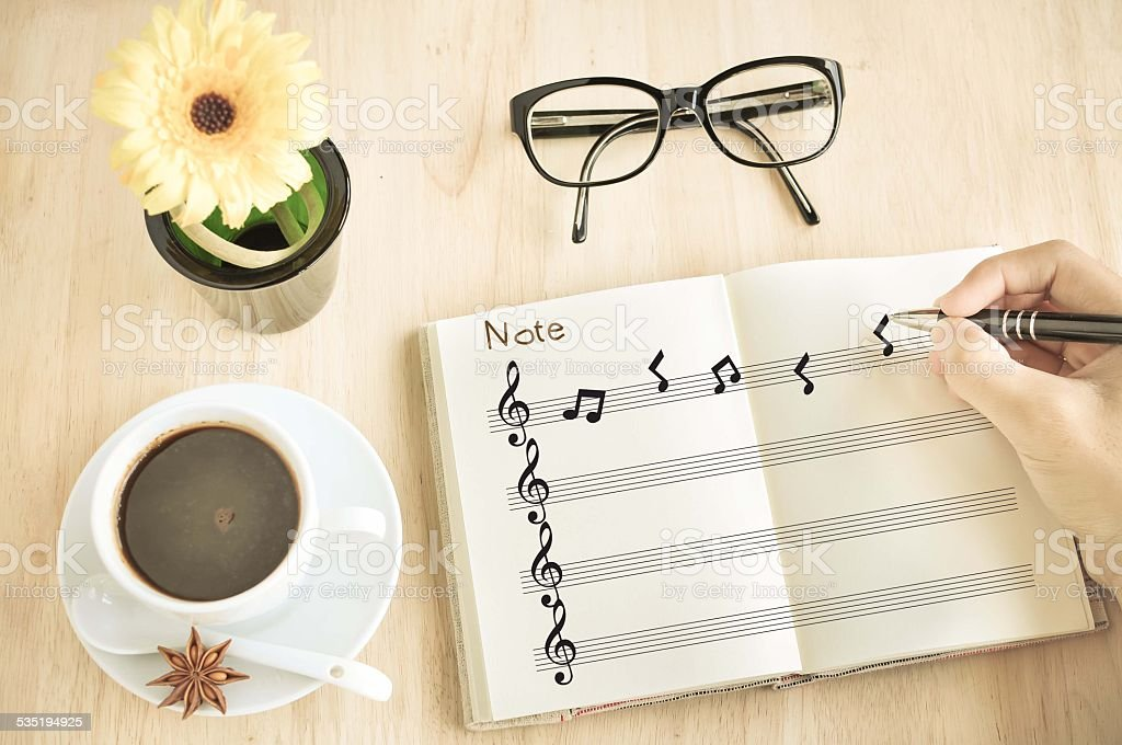 Composer with Music notes on notebook. stock photo