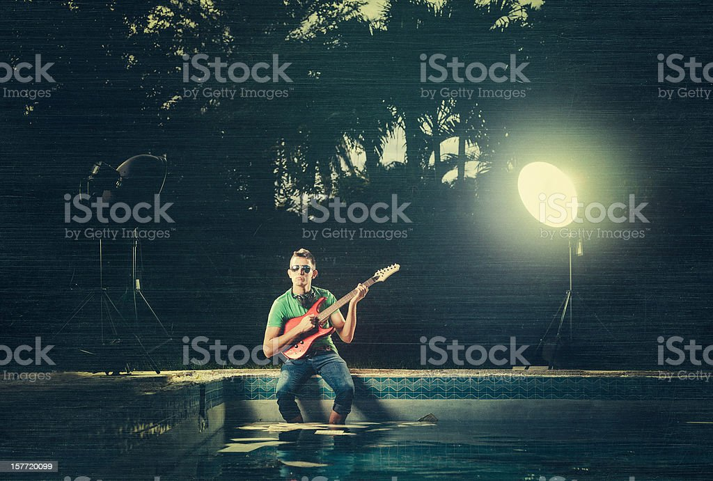 composing electric guitar by the pool royalty-free stock photo