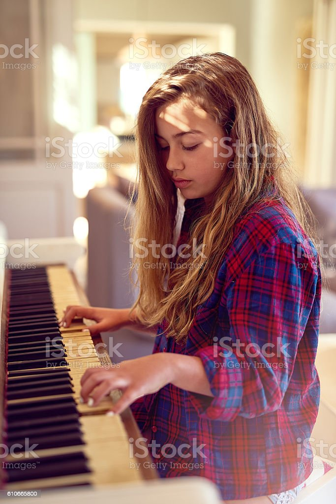 Composing her very own musical masterpiece stock photo