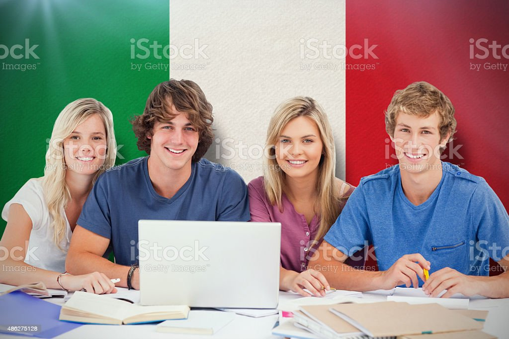 Composite image of a group of students with a laptop stock photo