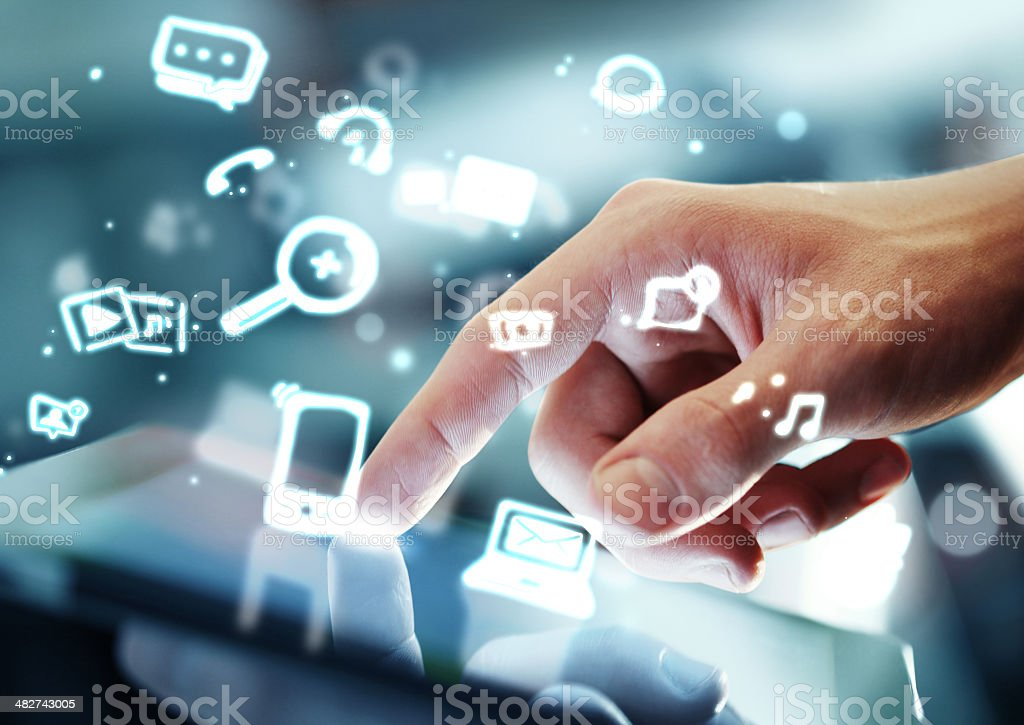 Composite image of a hand touching a tablet royalty-free stock photo
