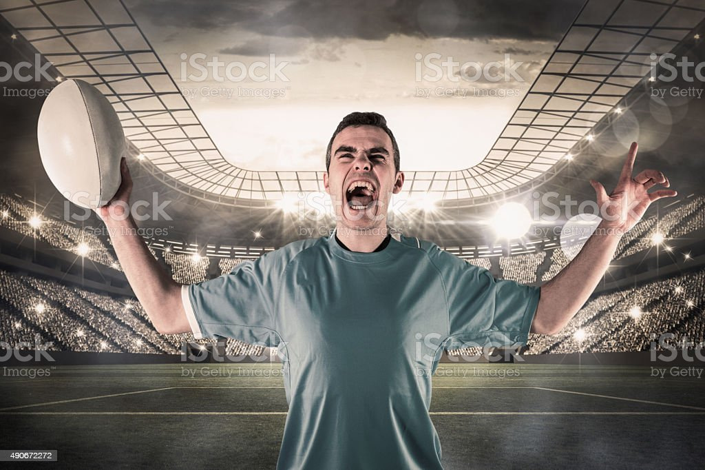 Composite image of a rugby player gesturing victory stock photo