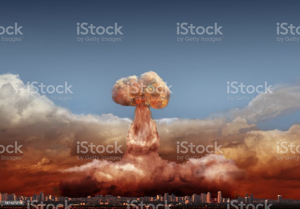 Composite image of atomic explosion behind a mock up city stock photo