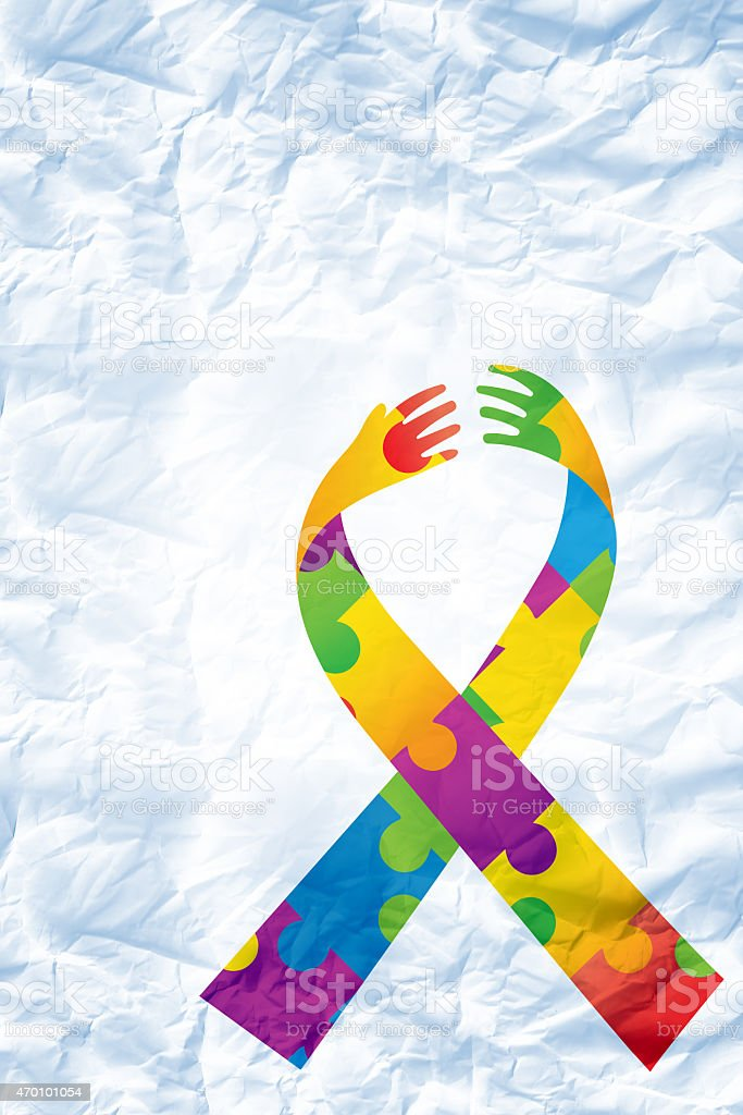 Composite image of autism awareness ribbon stock photo
