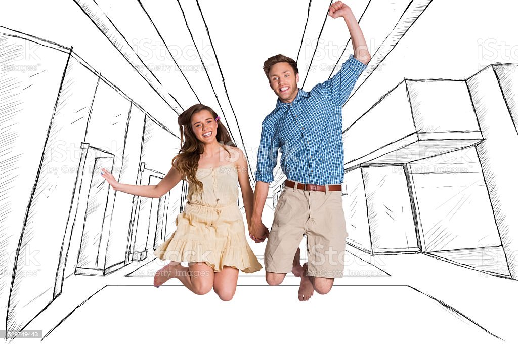 Composite image of cheerful young couple jumping stock photo