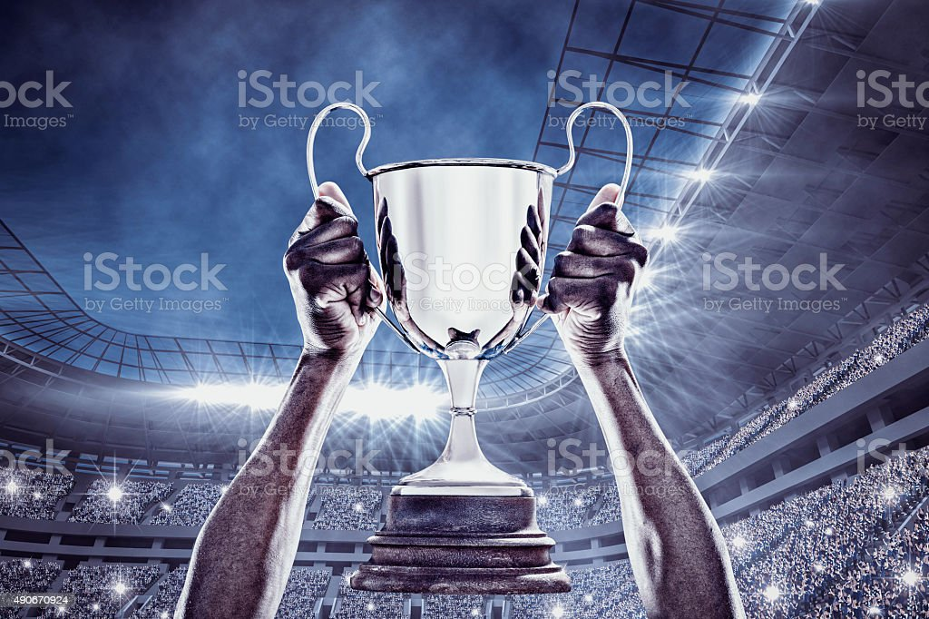 Composite image of cheering rugby player with cup stock photo