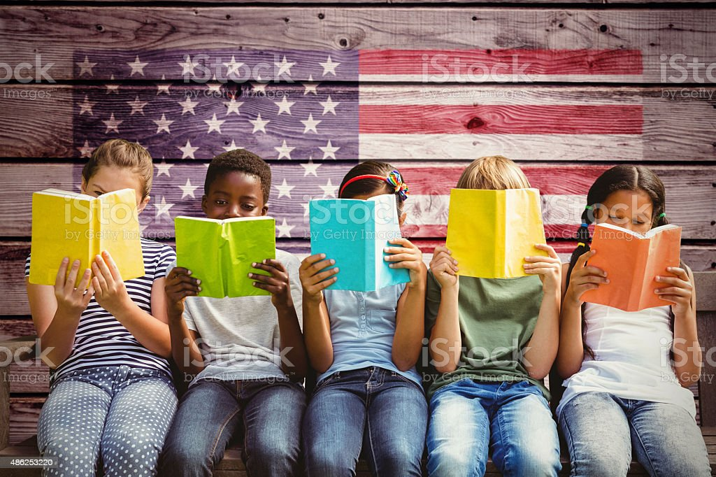 Composite image of children reading books at park stock photo