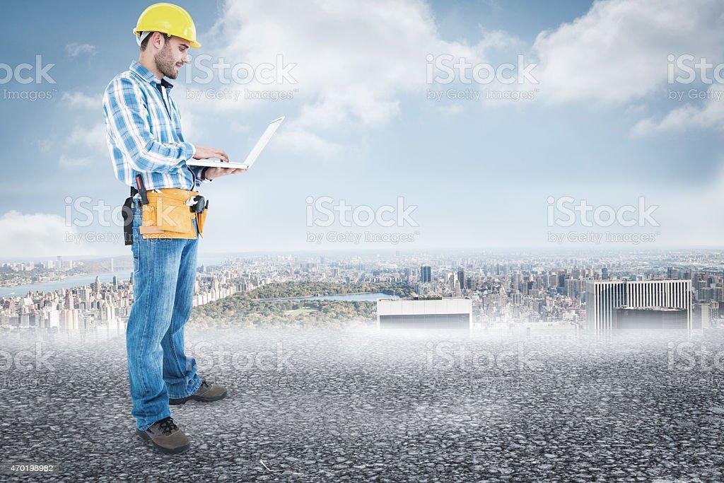Composite image of confident handyman stock photo