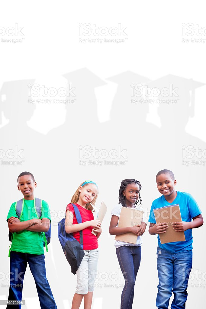 Composite image of cute pupils smiling at camera stock photo