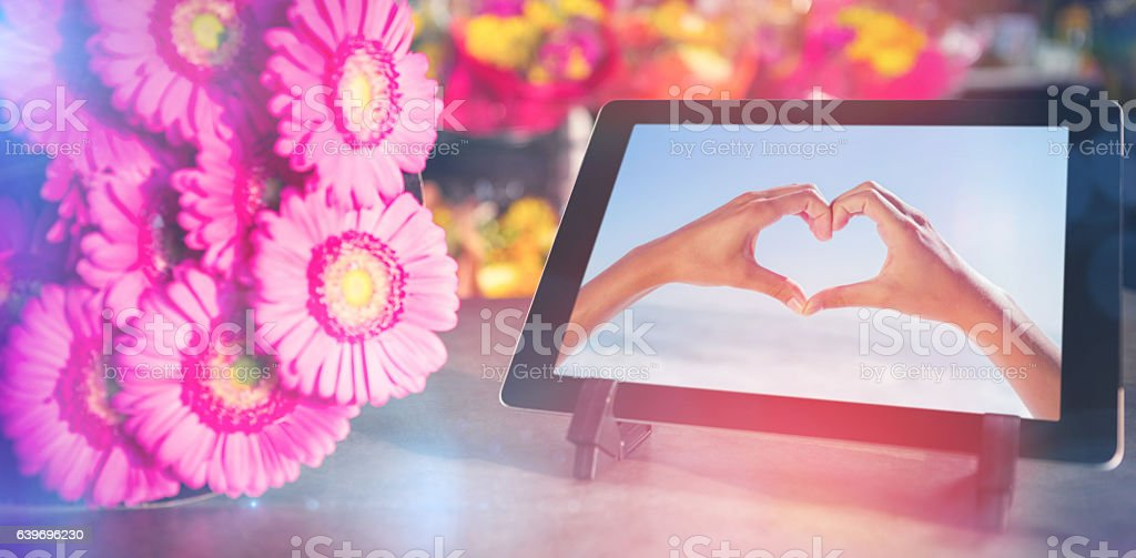Composite image of digital tablet with pink flowers stock photo