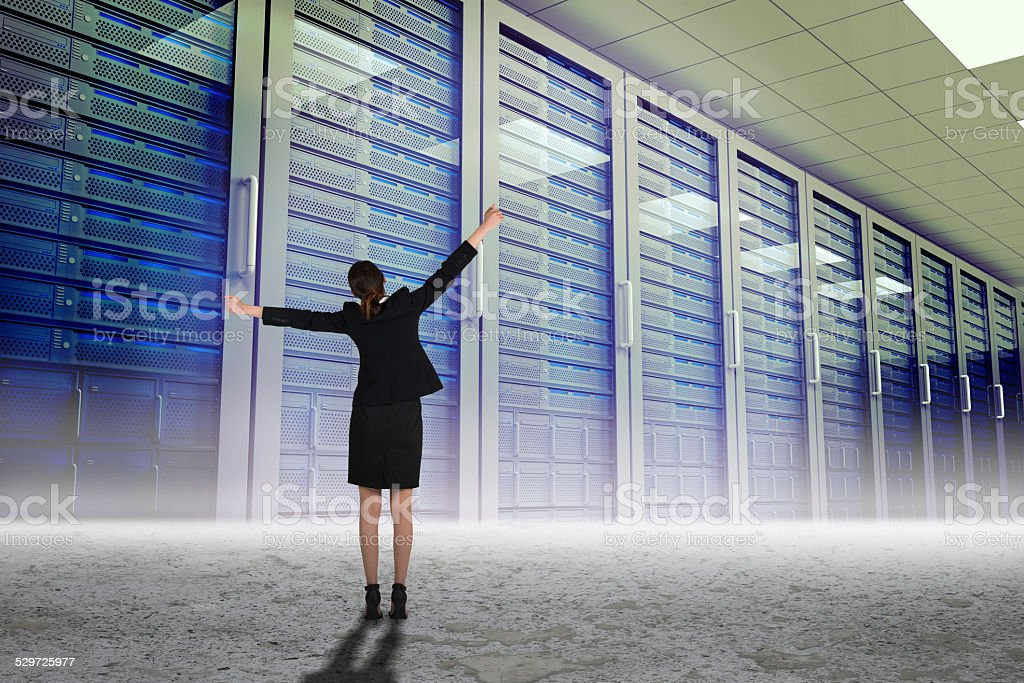 Composite image of excited businesswoman cheering stock photo