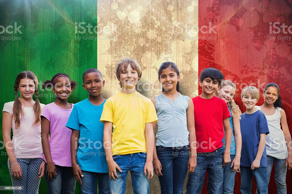 Composite image of happy friends playing in the park stock photo