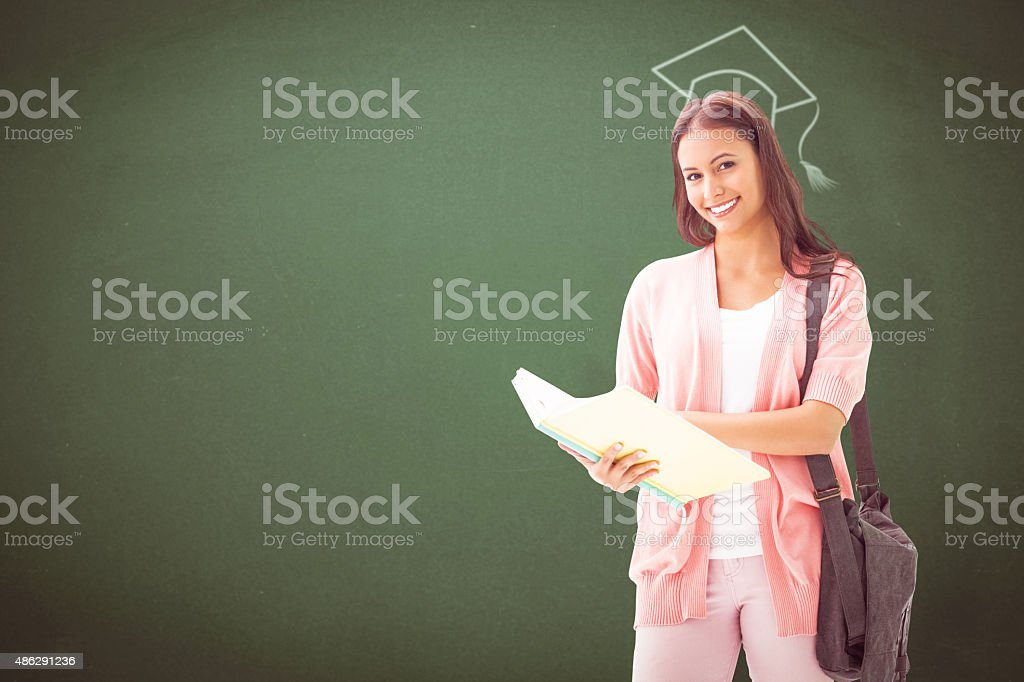 Composite image of pretty student smiling at camera stock photo