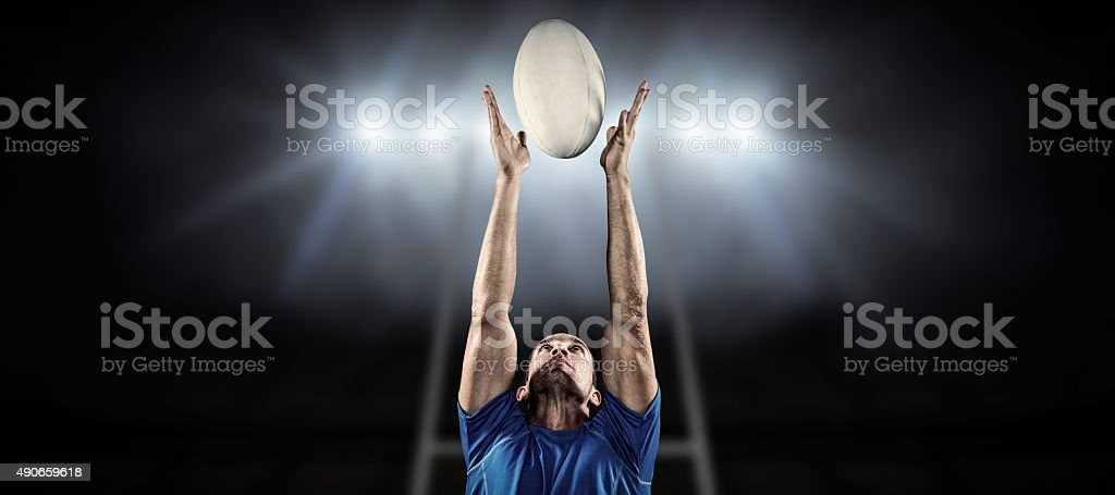 Composite image of rugby player catching ball stock photo