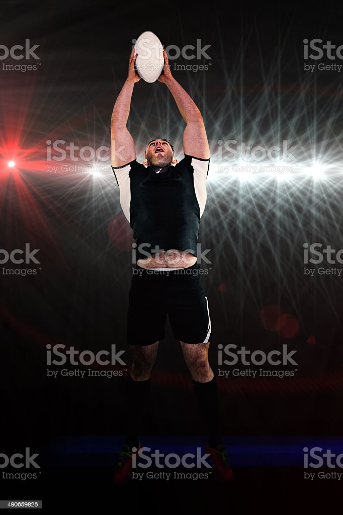 Composite image of rugby player catching the ball stock photo