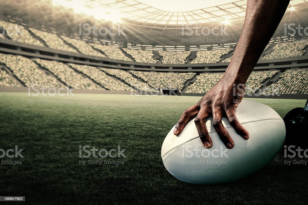 Composite image of rugby player holding ball stock photo