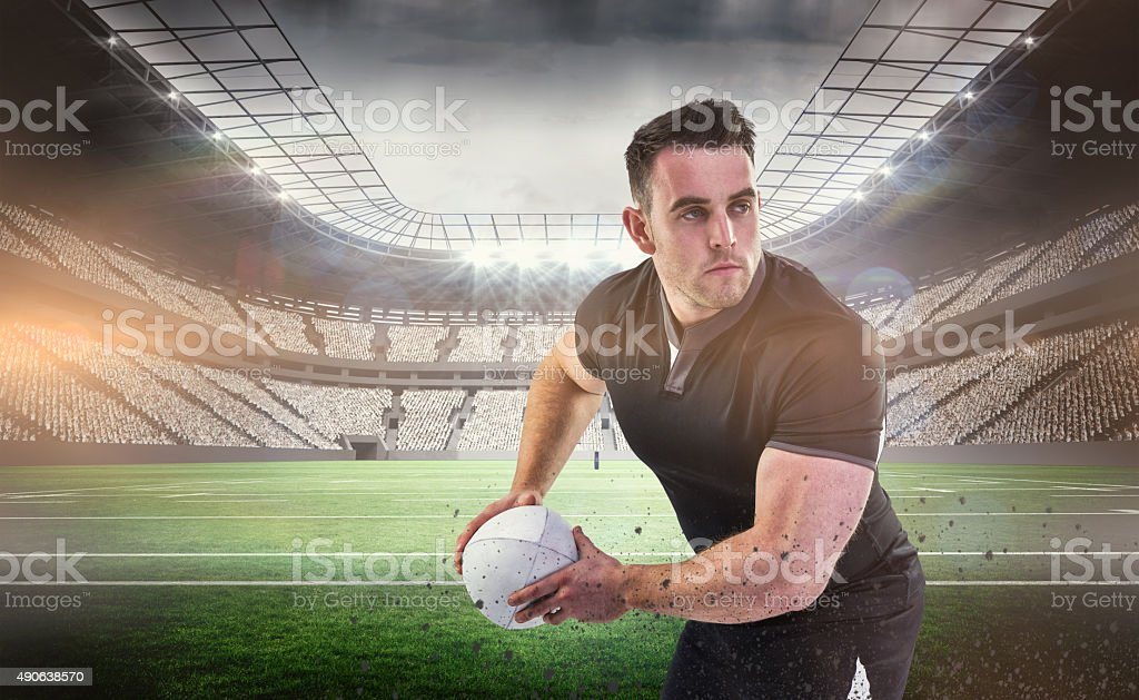 Composite image of rugby player throwing the ball stock photo