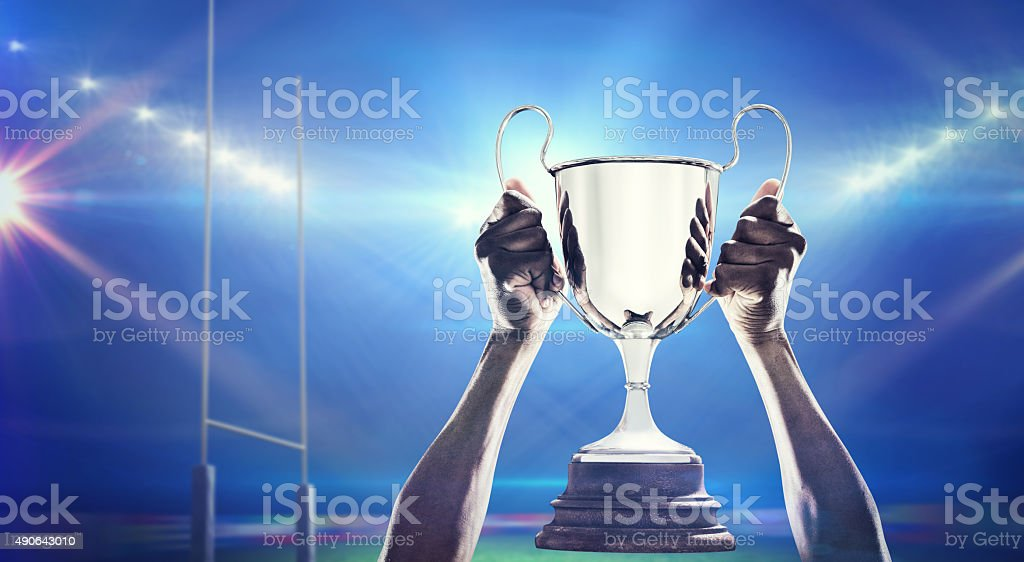 Composite image of rugby player with winners cup stock photo