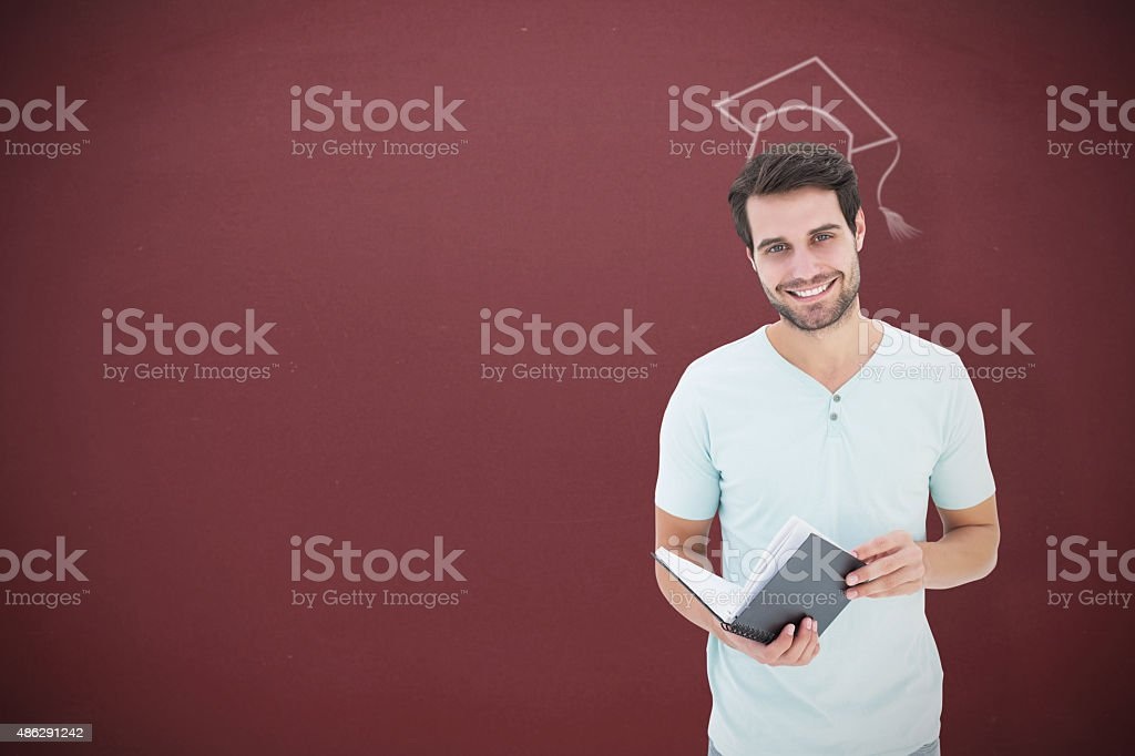 Composite image of student holding book stock photo