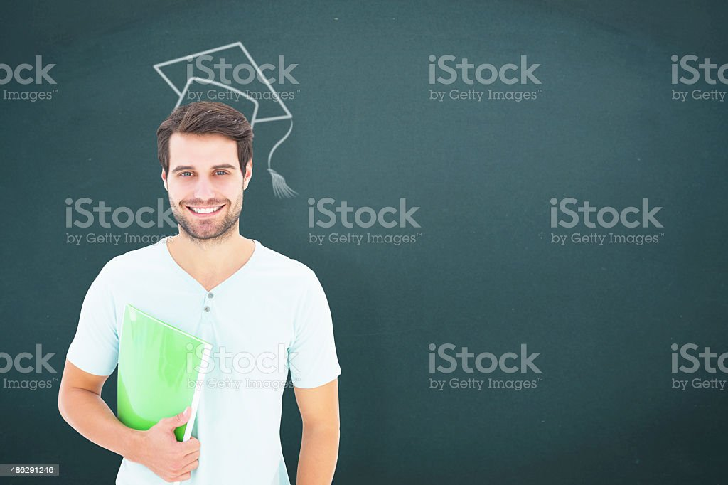 Composite image of student holding notepad stock photo
