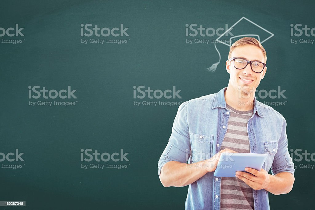 Composite image of student using tablet stock photo