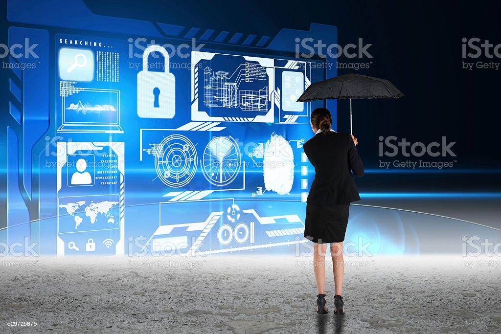Composite image of young businesswoman holding umbrella stock photo