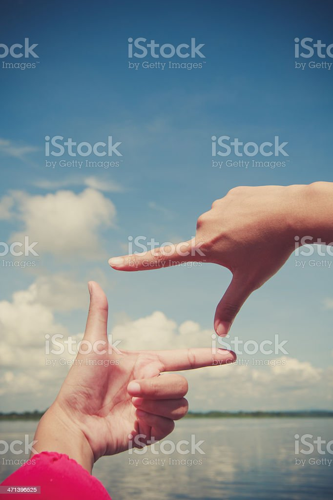 Composition hand frame on blue sky stock photo