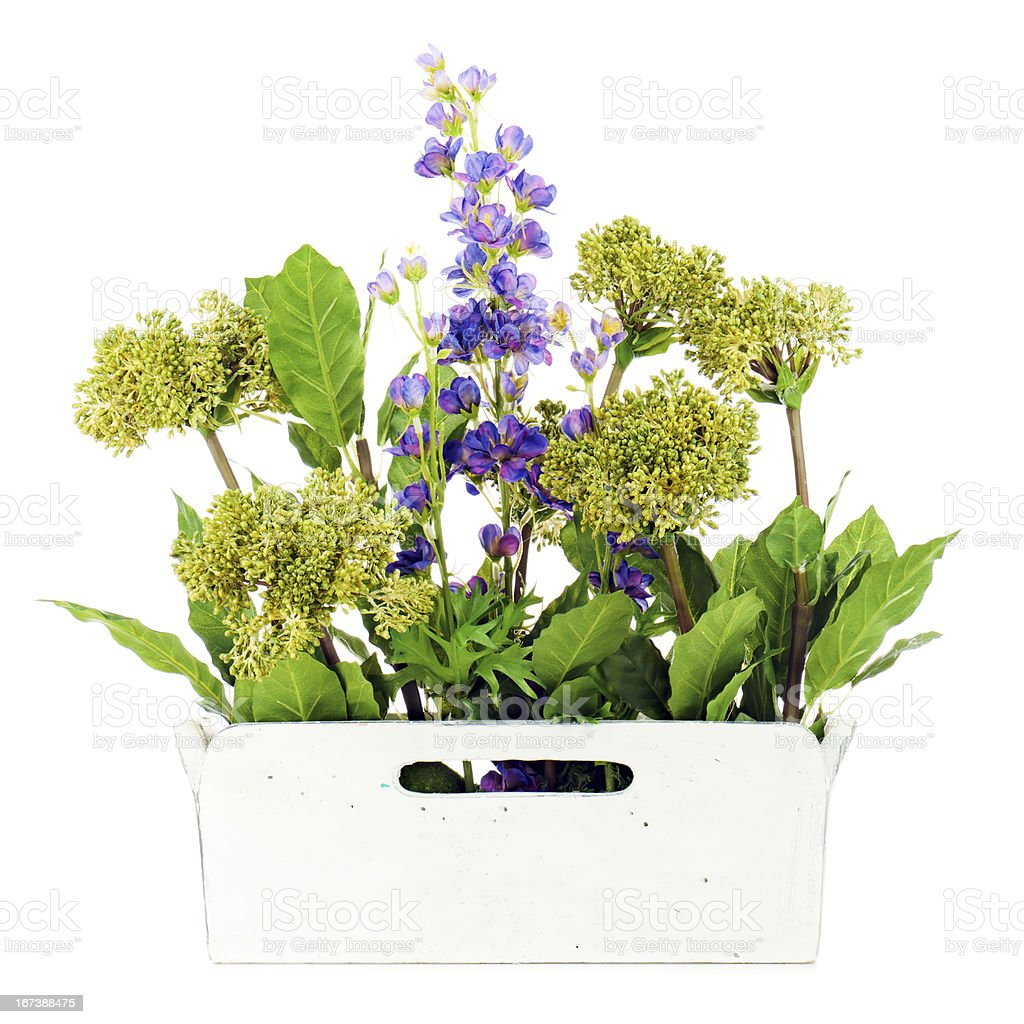 Composition of artificial garden flowers in decorative vase. royalty-free stock photo