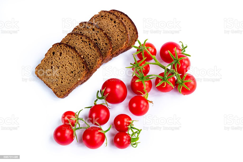 Composition of black bread slices and bunch of tomatoes stock photo