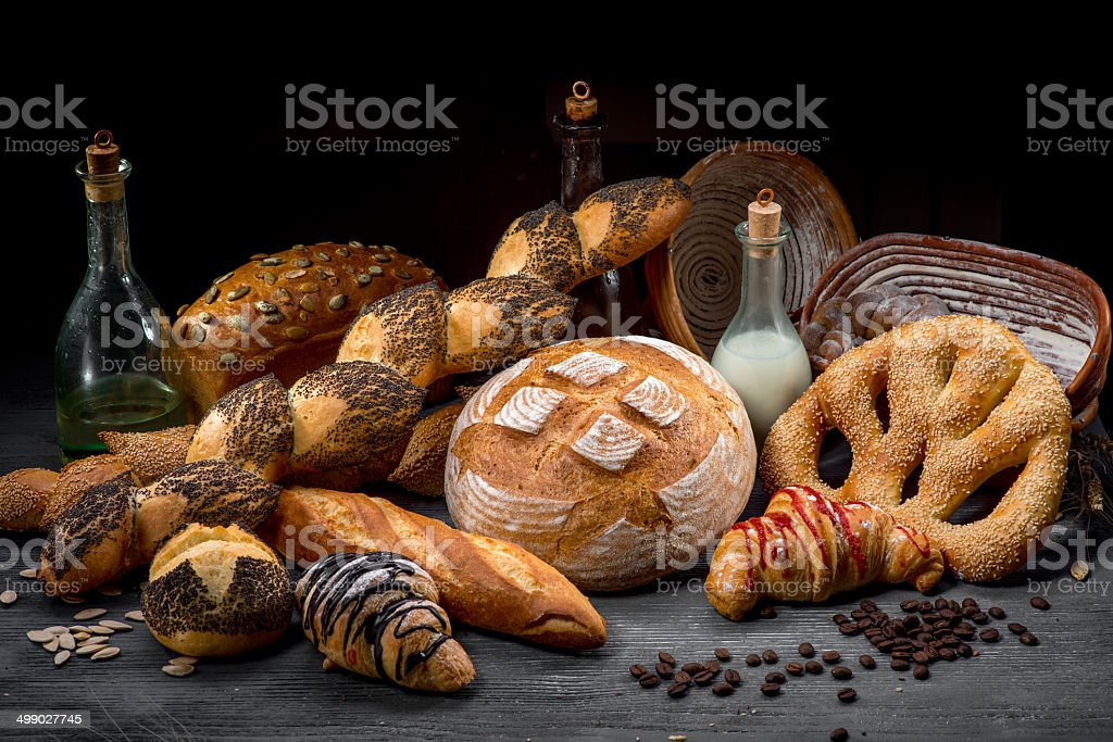 Composition of breads, croissants and rolls with milk. stock photo