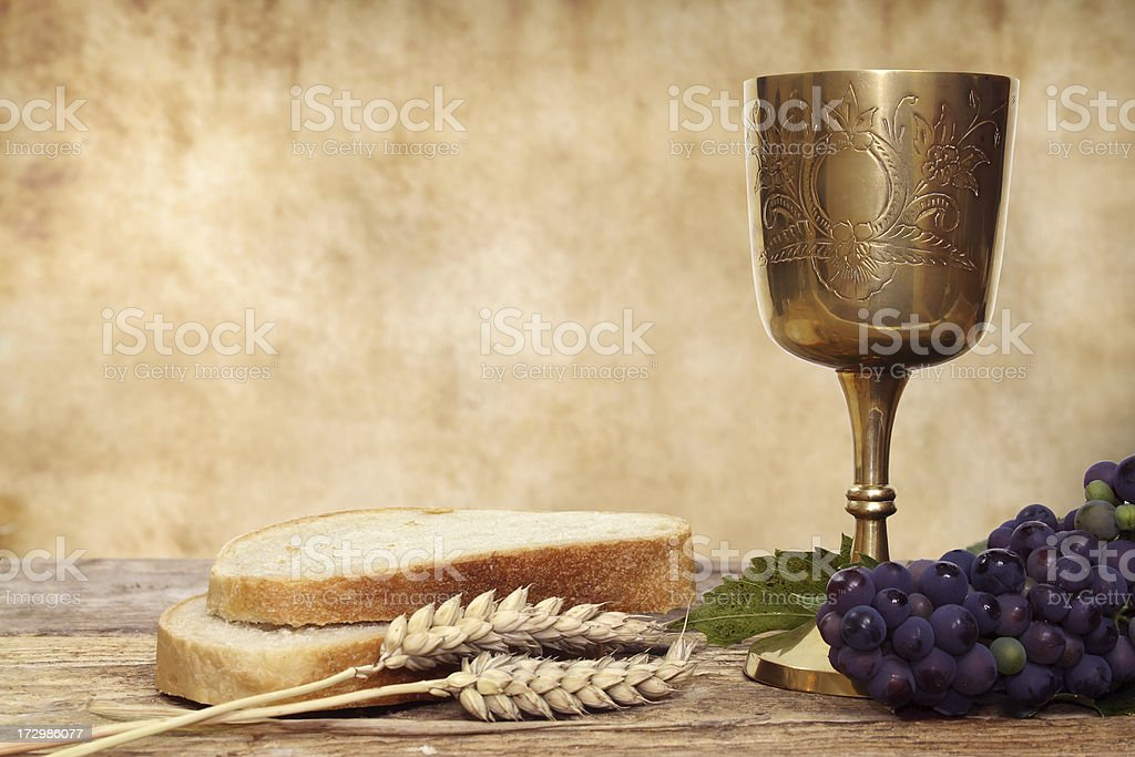 Composition of Communion chalice and bread stock photo