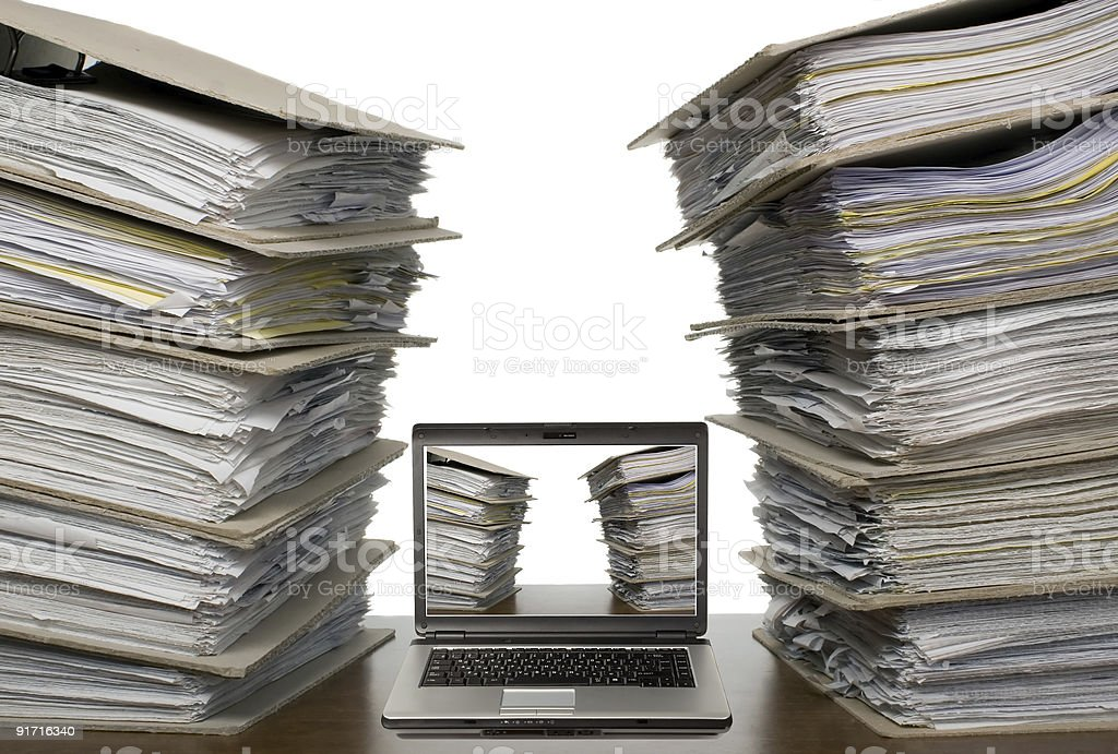 Composition of documents - laptop computer and paper catalogs royalty-free stock photo