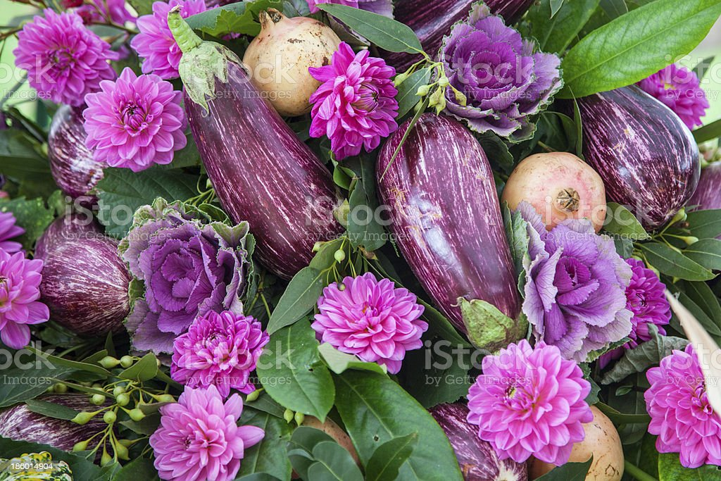 Composition of eggplant with pomegranates, cabbage and fuchsia dahlias royalty-free stock photo